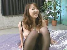 Eccitante milf giapponese in stocking